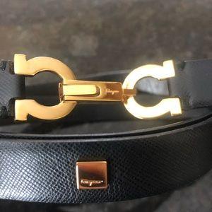 Ferragamo ladies black and gold belt